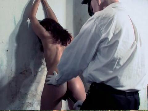 A policeman put a stick into a woman ass